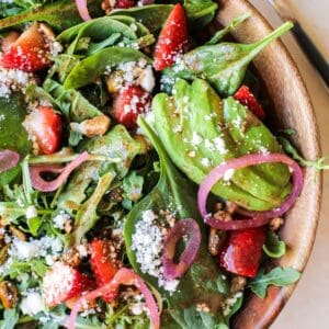 Close up shot of arugula spinach strawberry salad with strawberry vinaigrette