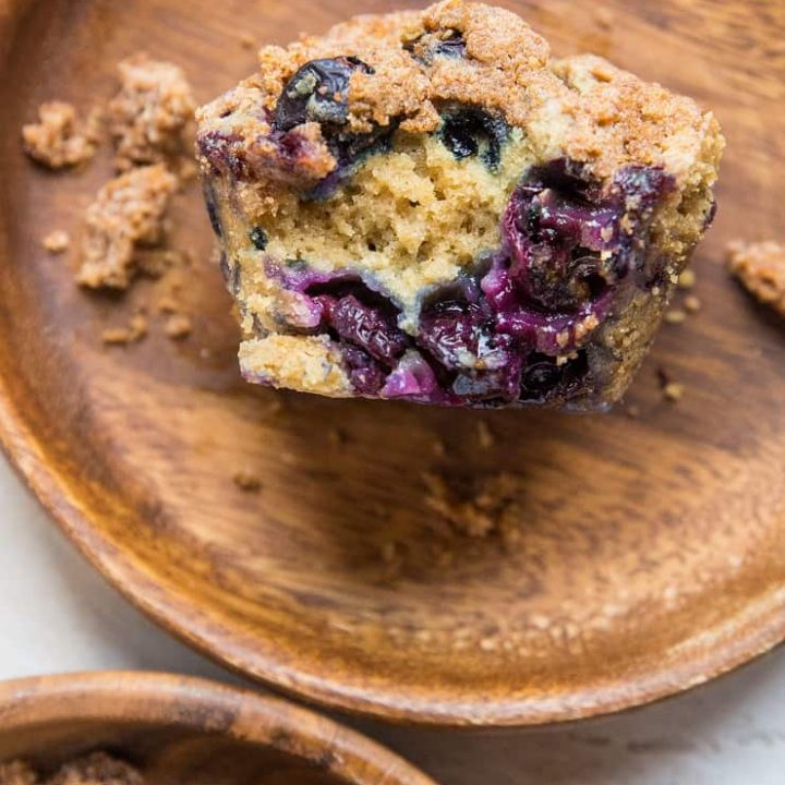 Two wooden plates with blueberry muffins on each