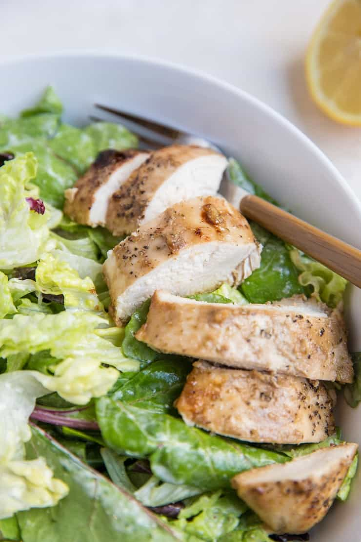 Close up photo of Balsamic Baked Chicken Caesar Salad in a bowl