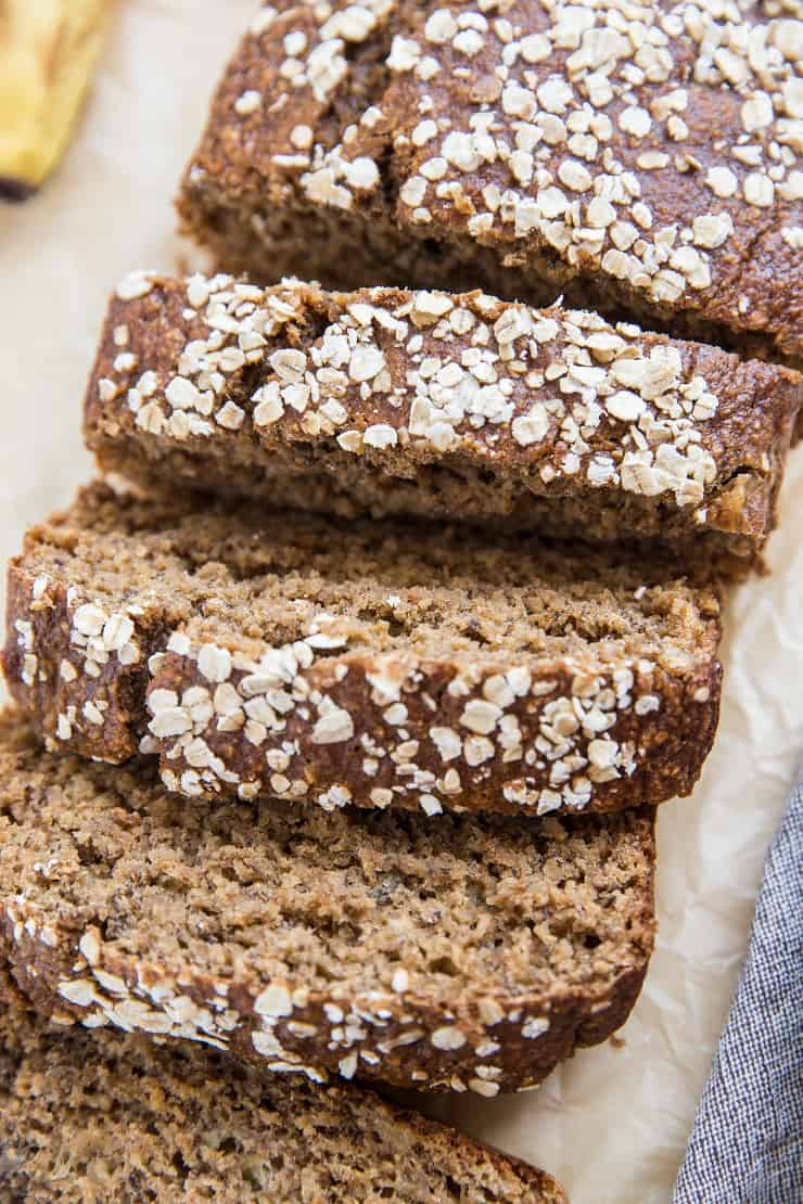 Loaf of dairy-free gluten-free oatmeal banana bread with slices cut