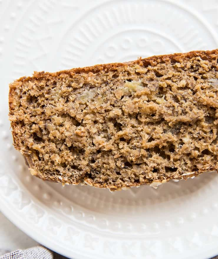 close up top down photo of slice of moist banana bread
