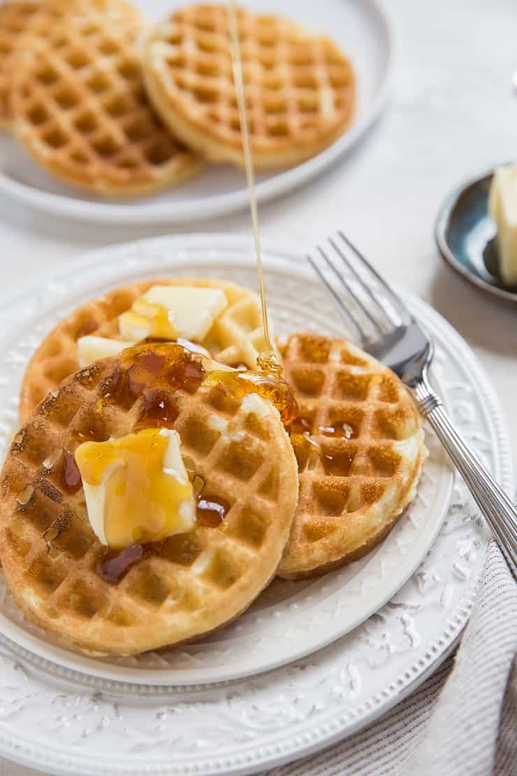 Sourdough waffles with honey being poured on top