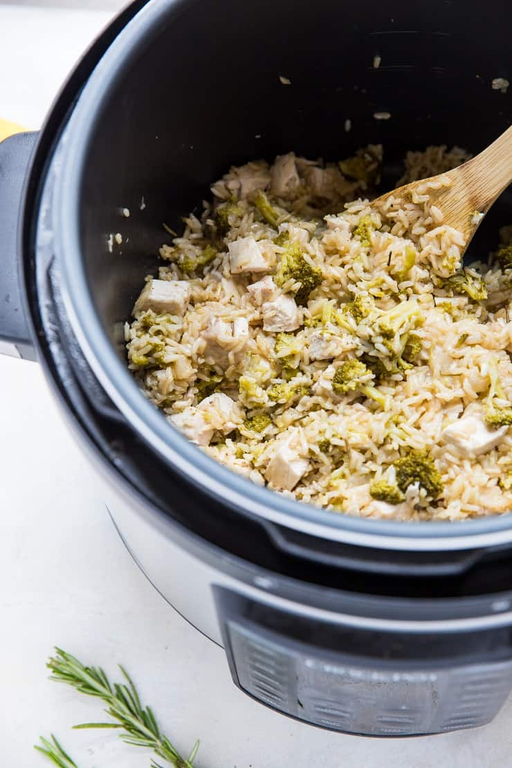 Pressure cooker with Rosemary Lemon Instant Pot Chicken and Rice in it