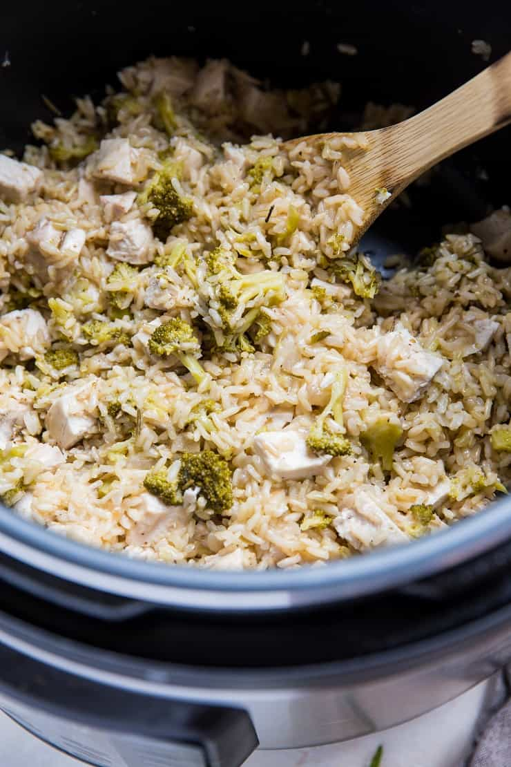 Stirring chopped chicken into Instant Pot with rice