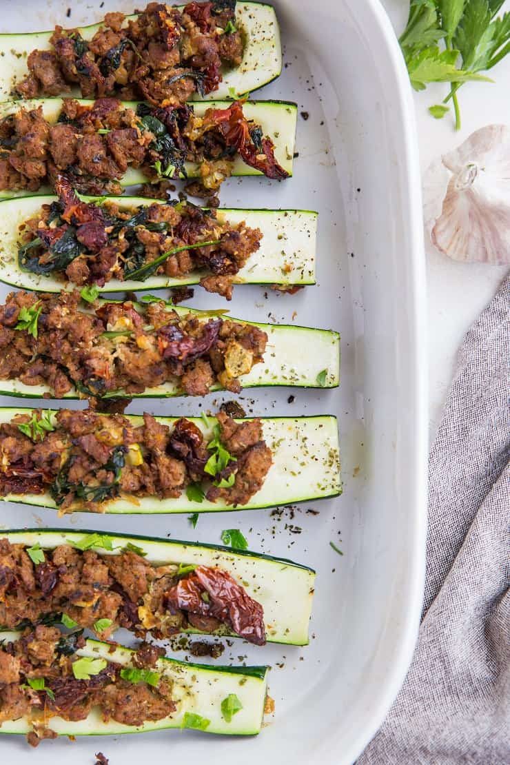 Stuffed Zucchini with Turkey Italian Sausage, Sun-Dried Tomatoes, and Spinach - a clean, healthy paleo and keto dinner recipe!