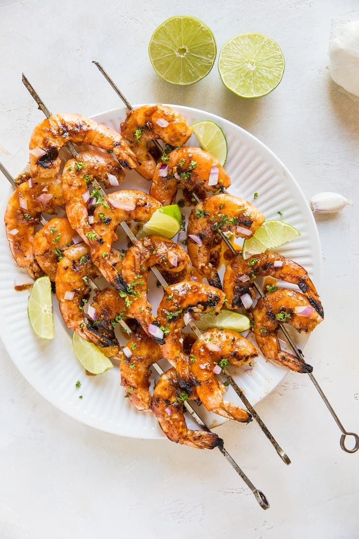 Chili Lime Grilled Shrimp Skewers - sweet and tangy glazed grilled shrimp made with only a few basic ingredients. A delicious paleo, keto, healthy low-carb appetizer or main entree for summer grilling.