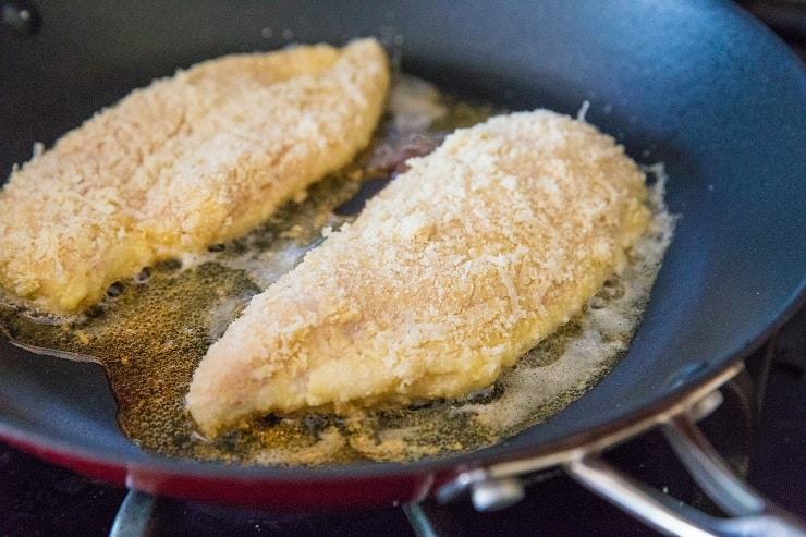 Pan frying breaded chicken for chicken parmesan