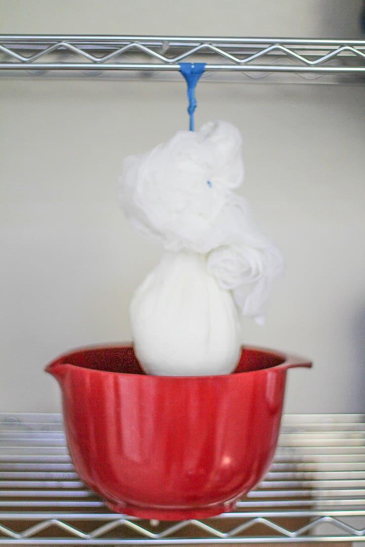 straining whey from yogurt using cheesecloth