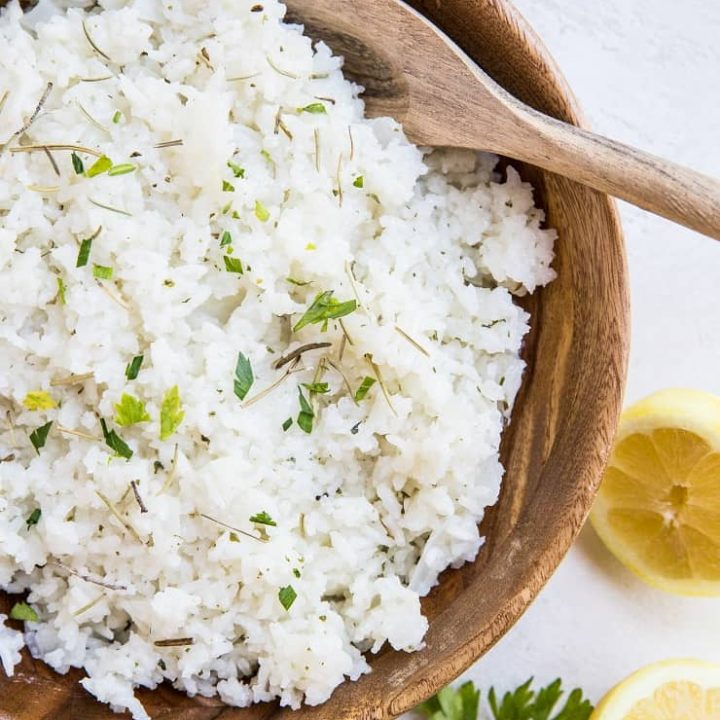 Zesty Buttery Lemon Rosemary Rice with sauteed onion and garlic is a flavorful side dish for any meal