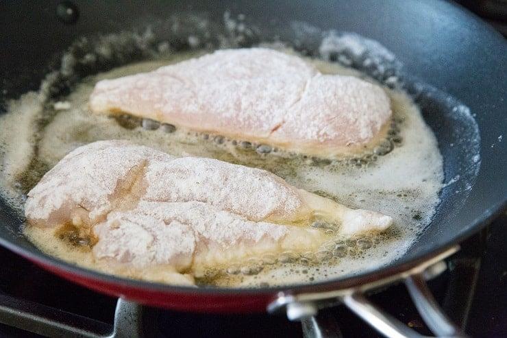 Pan frying breaded chicken in a skillet