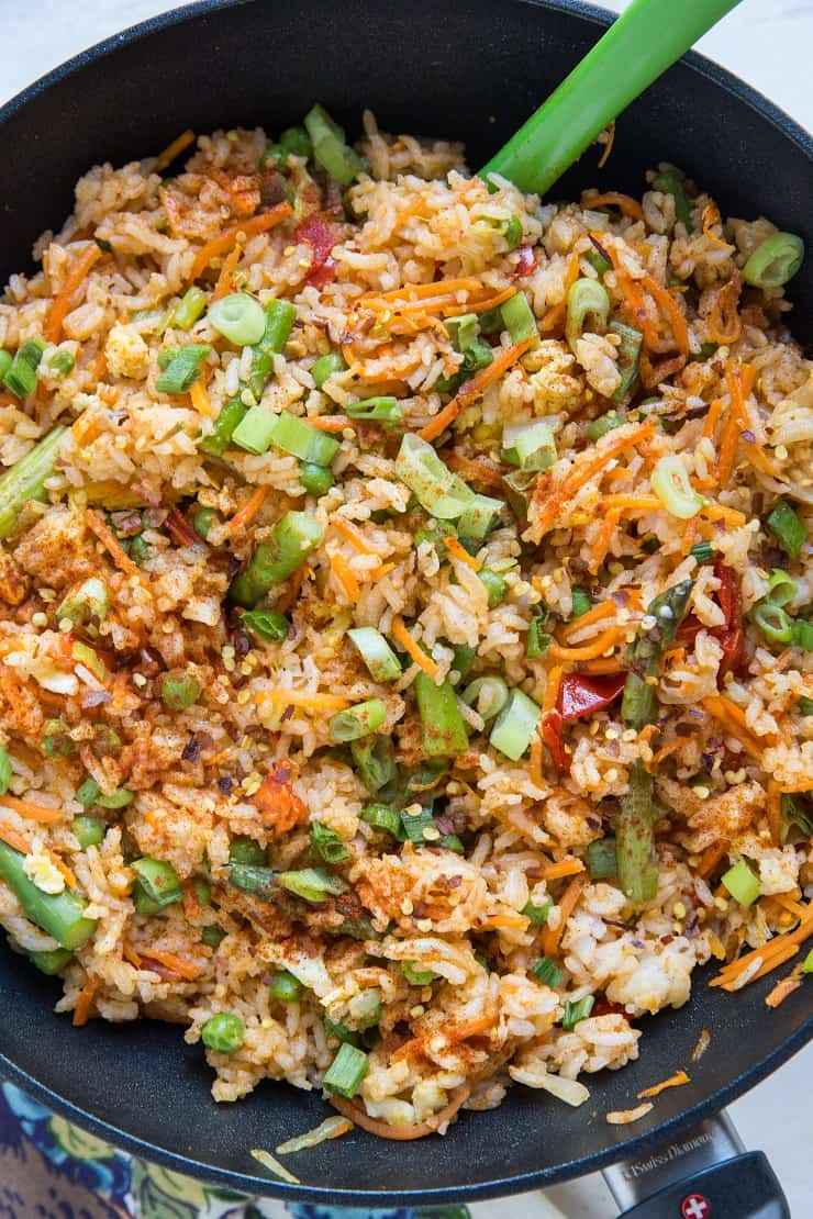 Vegetable Red Curry Fried Rice - Thai style fried rice with red curry paste, bell pepper, carrot, asparagus, green onion, and more