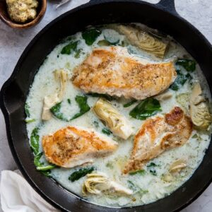 Creamy Chicken with Spinach Artichoke Sauce - an easy, healthy dinner recipe that is paleo, keto, whole30 and delicious!