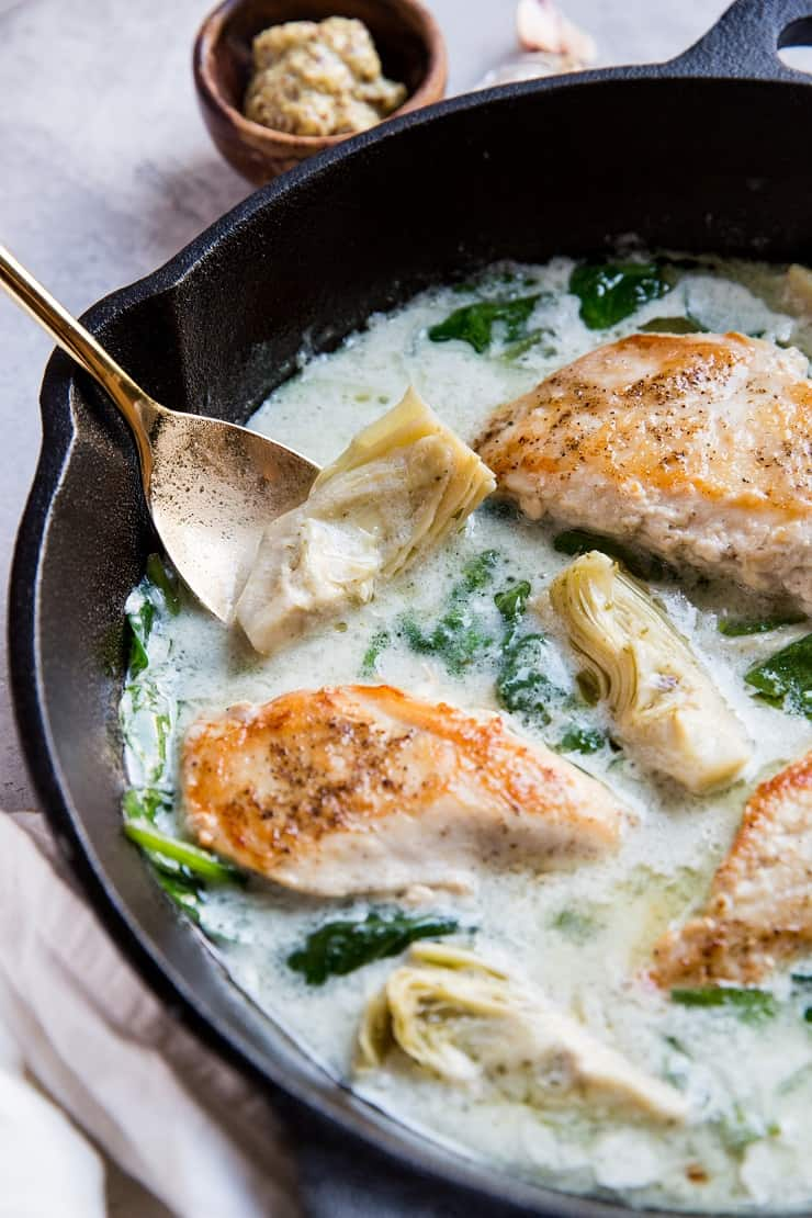 Pan-Cooked Chicken with Creamy Spinach Artichoke Sauce - a healthy dinner recipe that is gluten-free, paleo, keto, whole30 and delicious