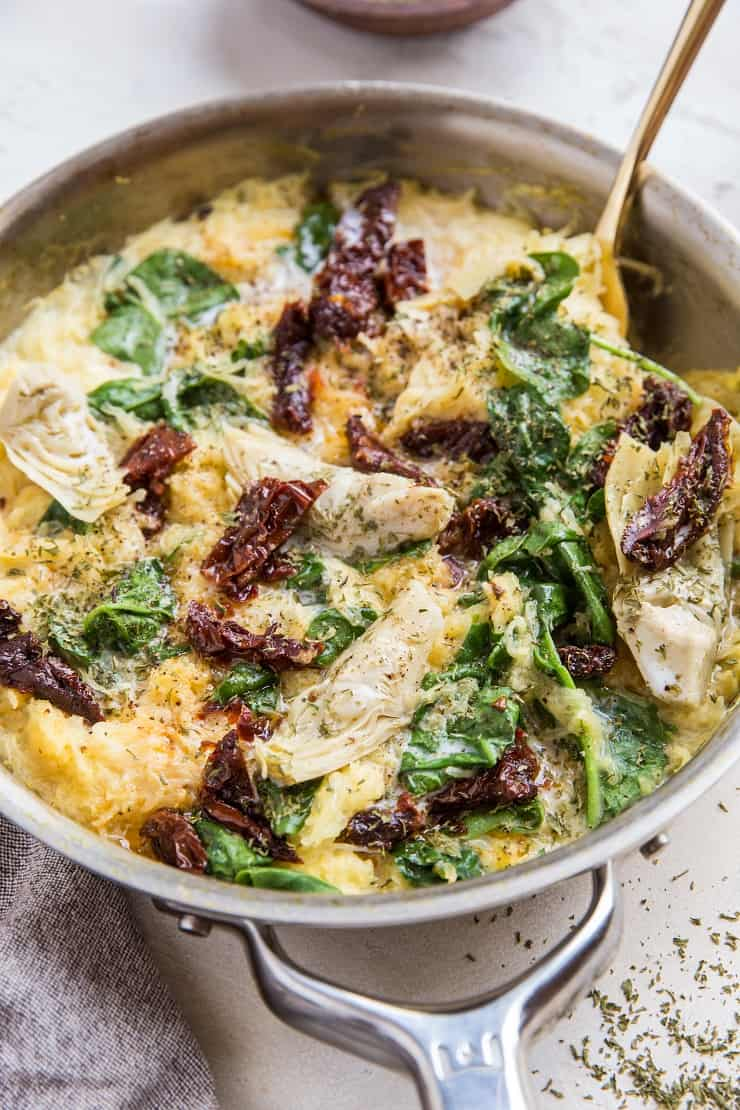 Paleo Tuscan Spaghetti Squash with sun-dried tomatoes, artichoke hearts and spinach - a creamy dairy-free spaghetti squash recipe that is vegan, low-carb and keto - make it as a side dish or main entree
