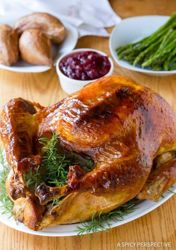 Cranberry Jalapeno Honey Baked Turkey from A Spicy Perspective  A sweet and spicy approach to your holiday meal! The most amazing turkey brine and glaze recipe, that produces a golden glistening juicy turkey with a crispy crust!