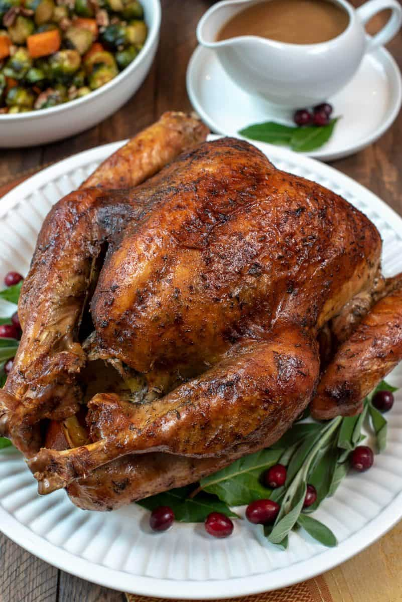Dry Brine Turkey with garlic Butter Rub from Valerie's Kitchen- The process of dry brining a turkey creates an incredibly tender, juicy result with beautifully browned, crispy skin. This Dry Brine Turkey with Garlic Butter Rub will make a gorgeous centerpiece for your holiday table.