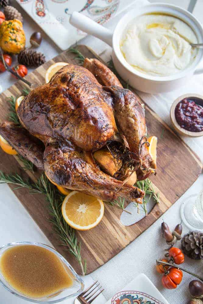 Dry Brine Turkey with Orange Rosemary Herb Butter from Perry's Plate  Dry brining is like wet brining without the water. It's more like a seasoning rub that you leave on the bird for a few days before cooking — at least 3 days and up to 4-5 days. This recipe uses salt, black pepper, and coconut sugar for the dry brine and includes a rosemary herb compound butter for roasting.