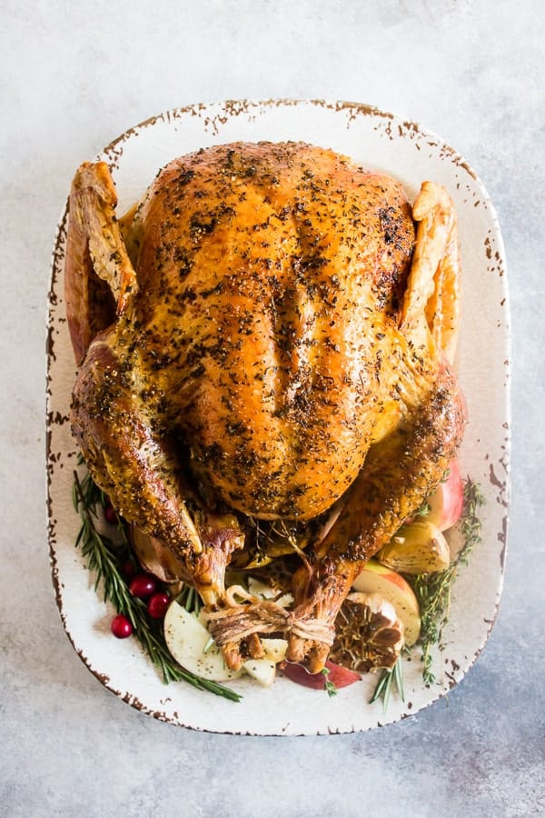 Garlic Herb Maple Roast Turkey from Nutmeg Nanny - This garlic herb maple roast turkey is packed full of flavor with just a touch of maple syrup sweetness. It's the perfect addition to any holiday table!