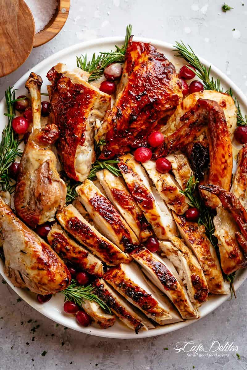 Garlic Herb Butter Roast Turkey from Cafe Delites -  Garlic herb butter roast turkey recipe (without a brine!) is succulent and tender on the inside with a golden, buttery skin and so much flavor! Dried out breasts and meat are a thing of the past with this perfect Turkey Recipe. Slathered with a garlic herb butter then oven roasted to get the most perfect, juicy meat and golden brown skin.