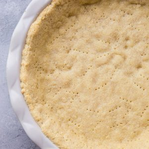 Almond Flour Pie Crust - keto, paleo, grain-free, dairy-free, and delicious! This pie crust recipe holds together very well and tastes just like regular pie crust