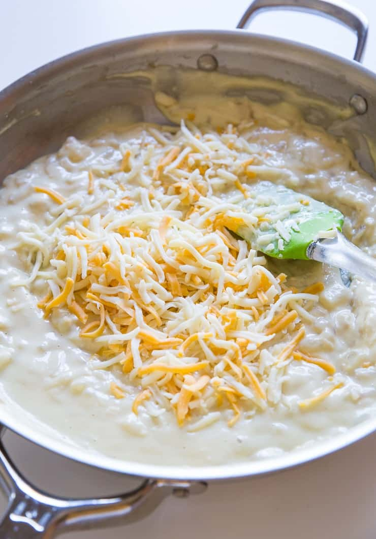 Add grated cheese to cream sauce