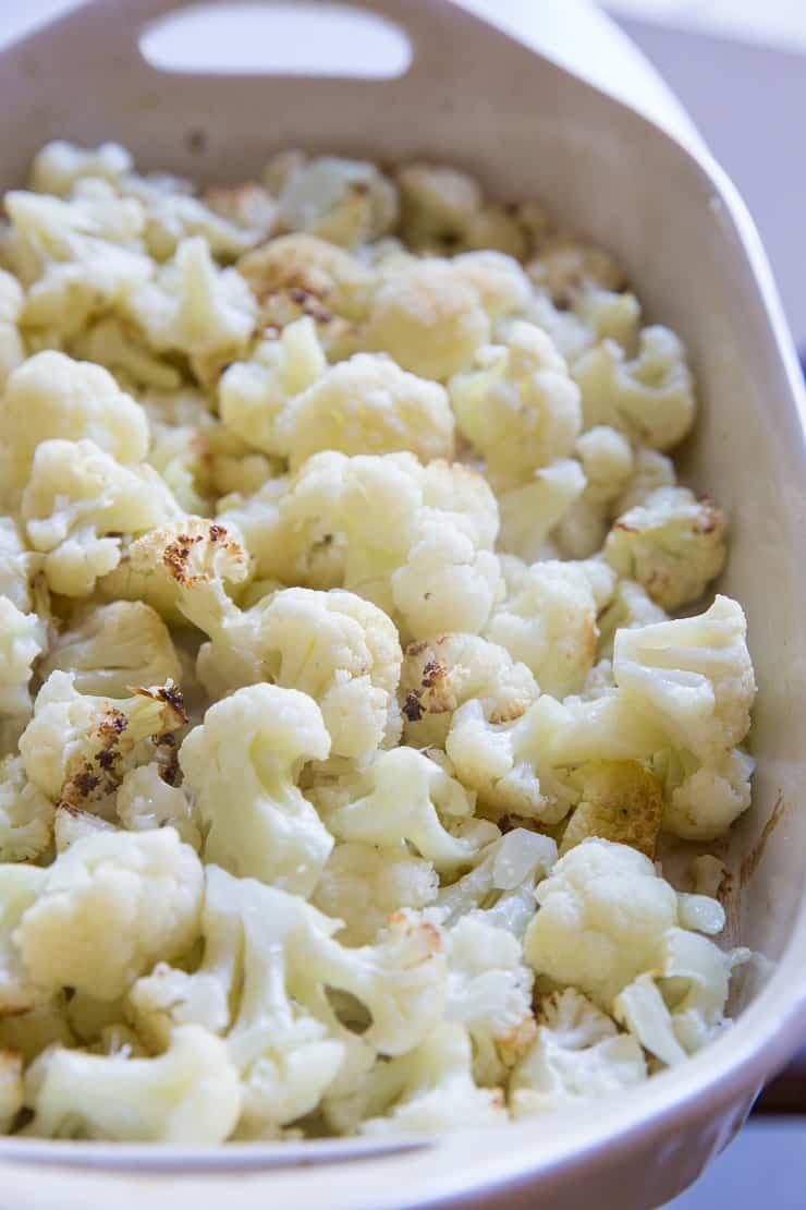 Roasted cauliflower in a large casserole dish