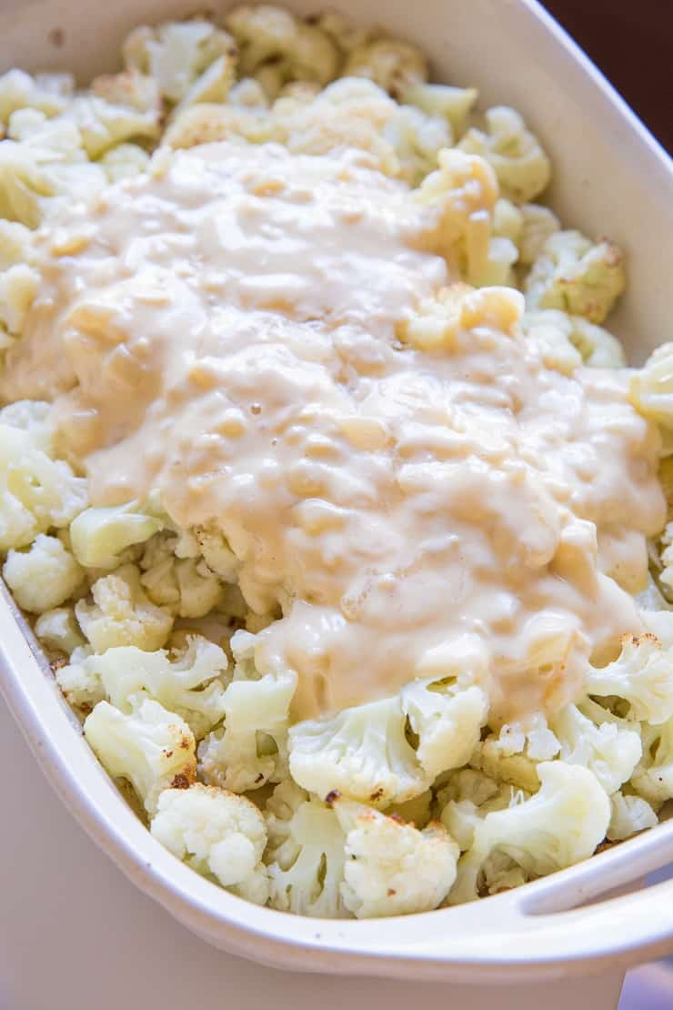 Creamy sauce poured on roasted cauliflower