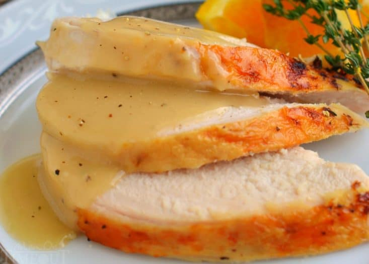 Crock Pot Turkey Breast with Herbs from Mom on Timeout - This Crockpot Turkey Breast recipe is hands down, the most amazing turkey you will ever eat! Juicy, tender, succulent and bursting with flavor, this easy recipe is a necessary addition to your holiday feast!