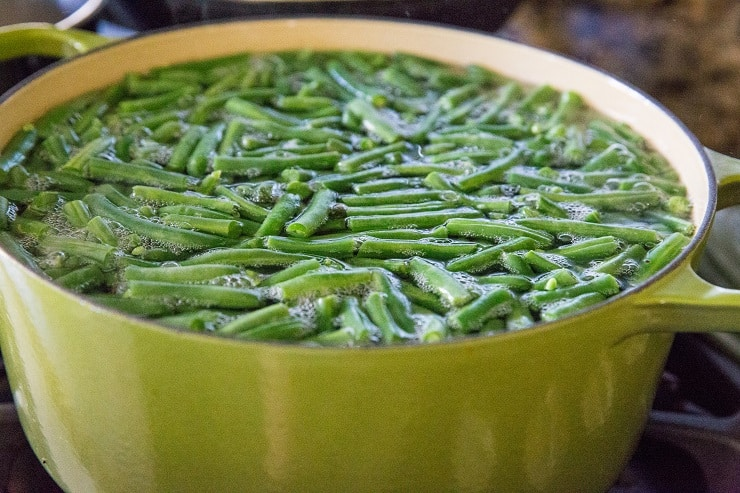 Boil green beans on the stove top