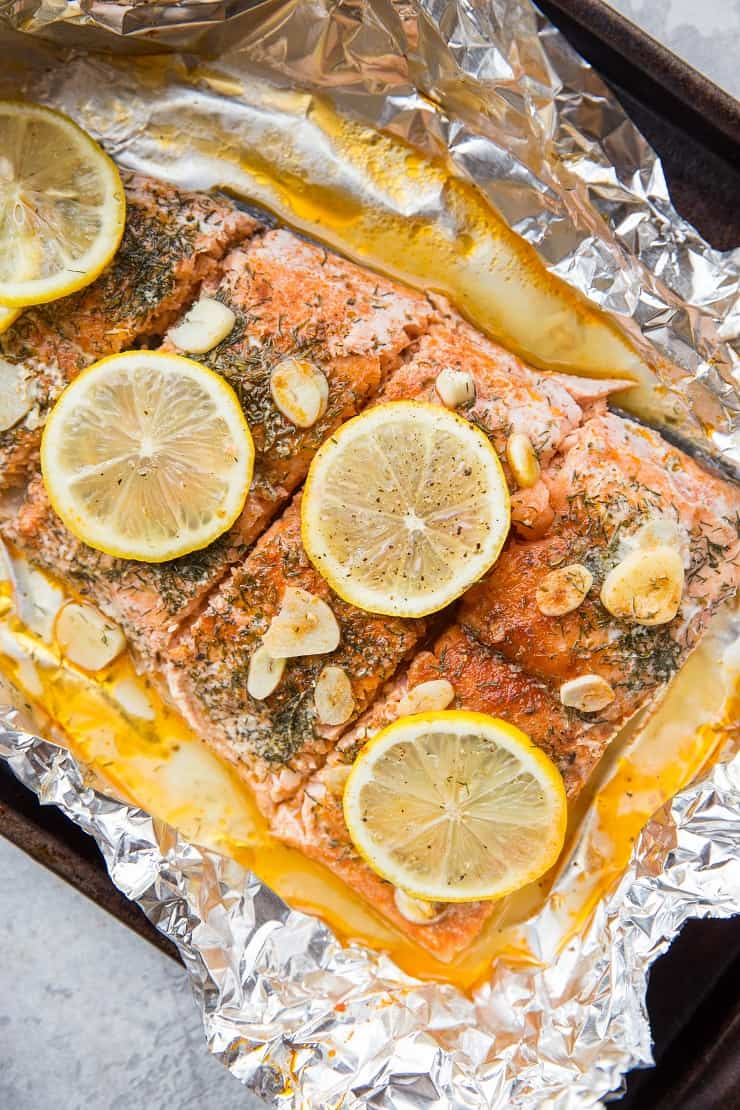 How to Bake Salmon in Foil with garlic and lemon - an easy dinner recipe that is healthy, paleo, keto, whole30, and delicious