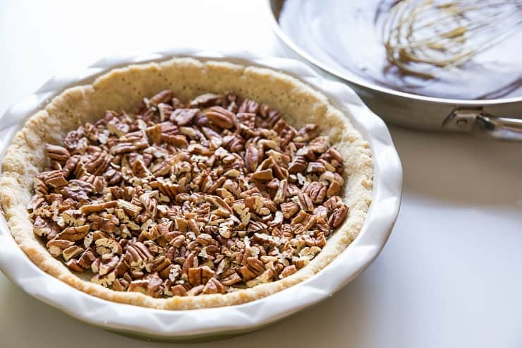 Add the pecans to the prepared pie crust in an even layer