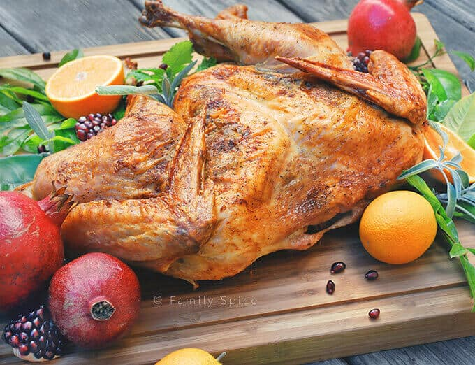 Orange and Sage Spachcooked Turkey from Family Spice - Butterflying a turkey takes a little muscle, but there is plenty of crispy skin in this Orange and Sage Spatchcocked Turkey. And the cooking time gets cut in half, too!