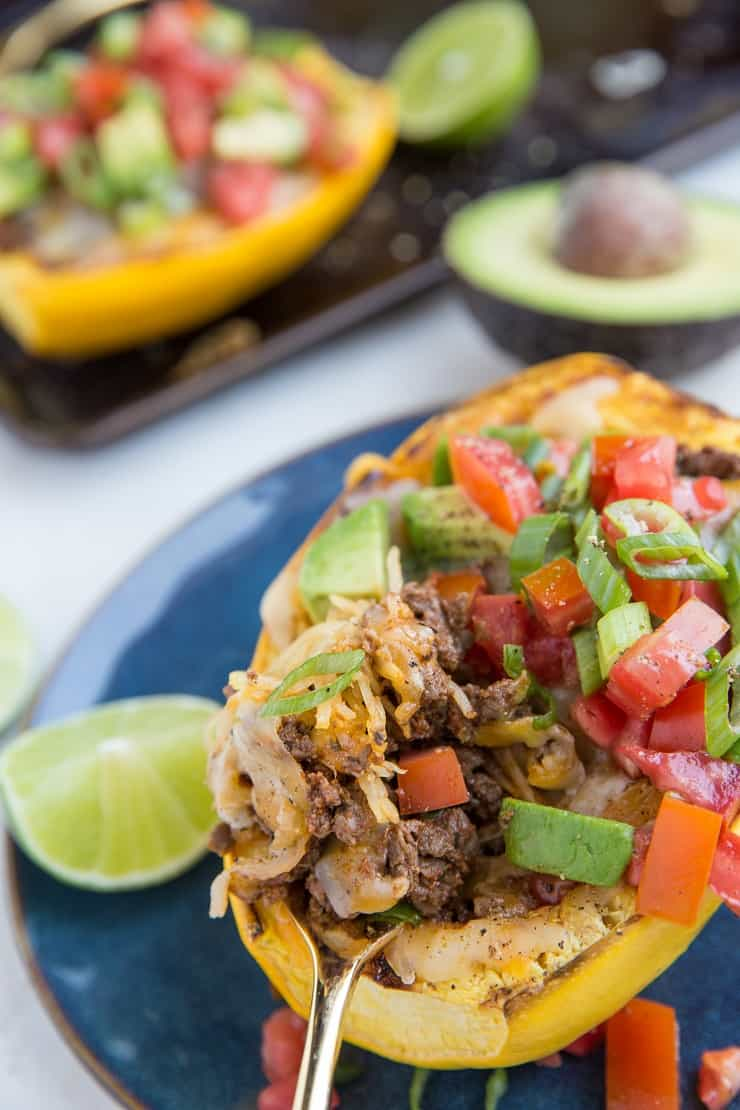 Keto Low-Carb Burrito Bowls with spaghetti squash, ground beef, cheese, salsa, avocado and more!