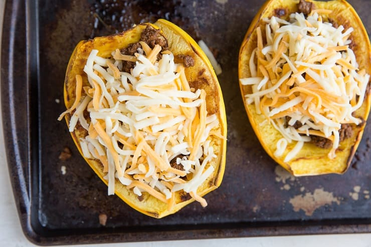Spaghetti Squash stuffed with ground beef and sprinkled with cheese
