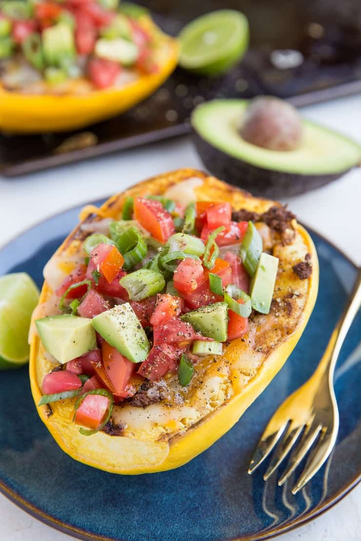 Spaghetti Squash Burrito Bowls with ground beef, cheese, tomatoes, avocado and more. An easy, healthy low-carb, keto dinner recipe.