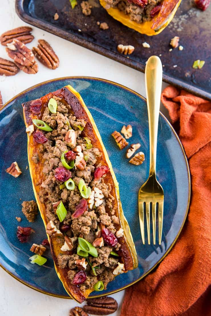 Stuffed Delicata Squash with ground beef, cranberries, pecans and green onion - a healthy dinner recipe that can be made any night of the week. Paleo, whole30, nutritious