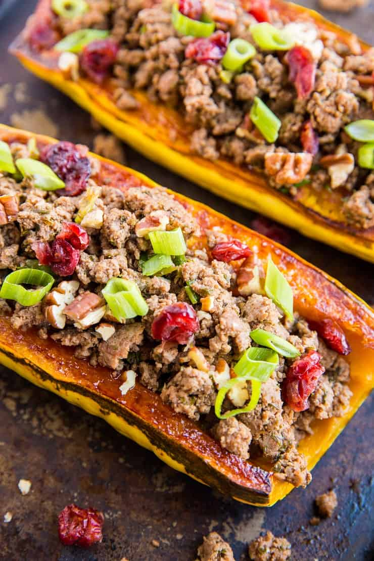 Ground Beef Stuffed Delicata Squash with pecans, dried cranberries, onion, and garlic - a healthy paleo, whole30 dinner recipe