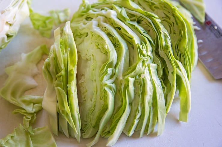Slice the cabbage and remove tough inner core