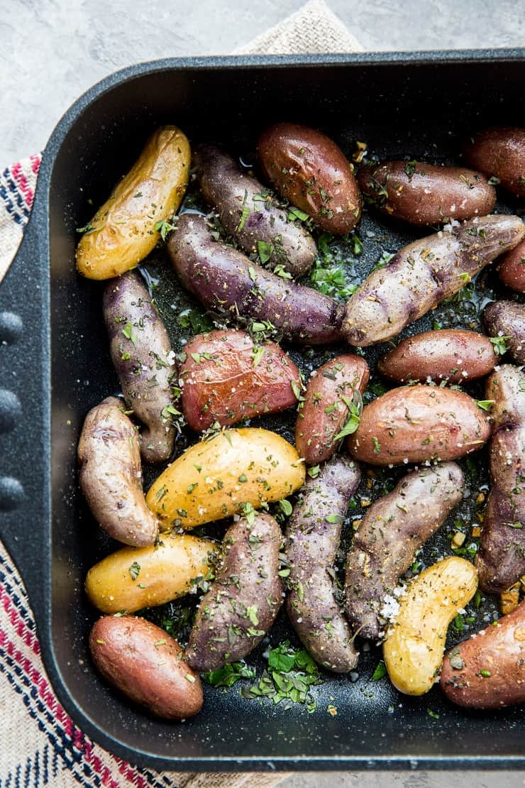 Garlic Roasted Potatoes - an easy recipe for herby garlicky fingerling potatoes with the perfect crisp. A delightful side dish to any meal!