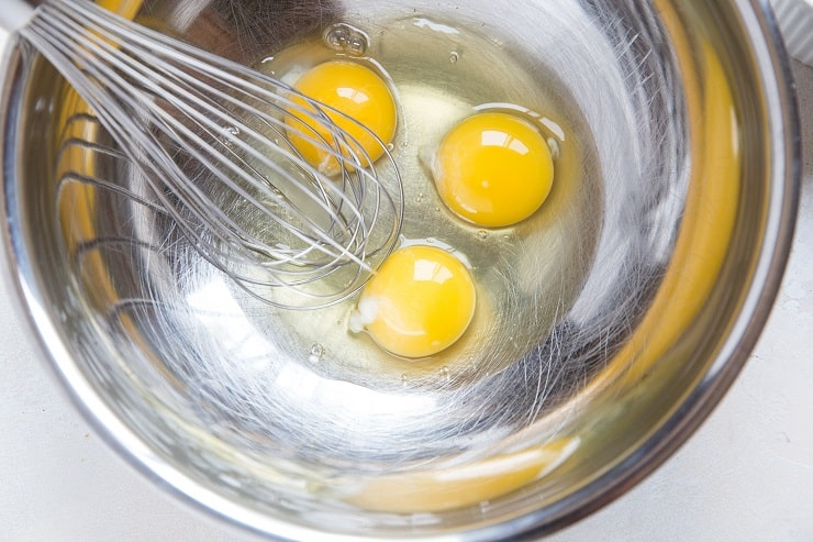 Eggs in a mixing bowl to make biscuits