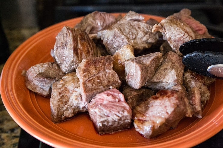 Transfer browned meat to a plate