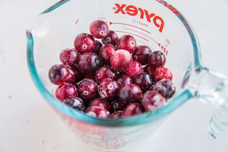 Toss cranberries in coconut flour