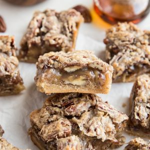 Vegan grain-free pecan pie bars that are paleo, dairy free, refined sugar free and healthier.  A delicious sticky pecan and caramel bar on a shortbread crust