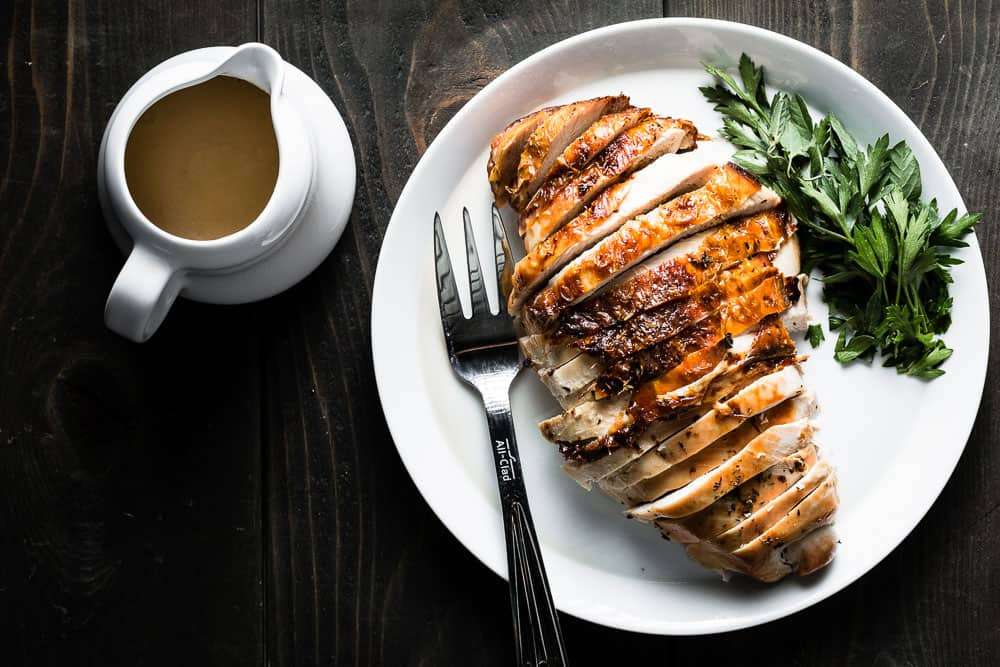 Herb Roasted Turkey Breast from Salt and Pepper Kitchen - Roasting just the turkey breast is a delicious and pain-free alternative to cooking a whole turkey. Brining it first guarantees tons of flavor and juicy turkey in every bite!!