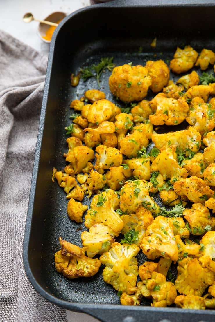 Turmeric Roasted Cauliflower with garlic and sriracha - an easy healthy side dish that is paleo, vegan, whole30, and keto