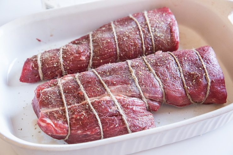 Wrap beef tenderloin with string for even cooking