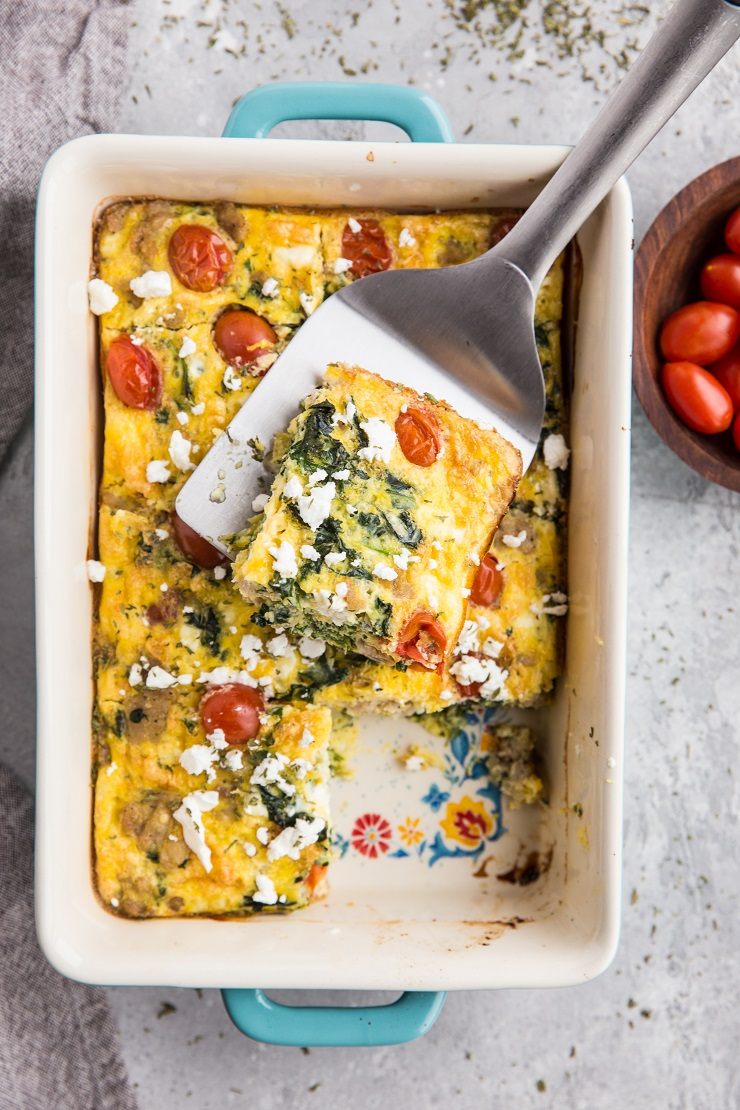 Mediterranean Keto Breakfast Casserole with sausage, kale, feta and tomatoes