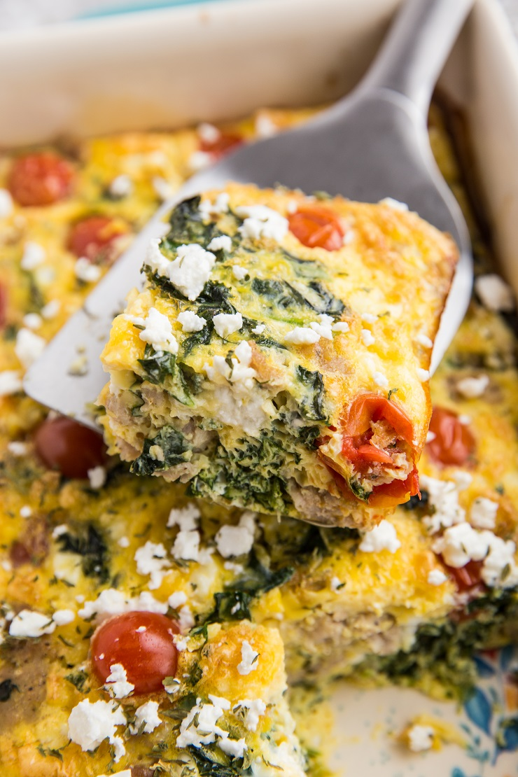 Healthy Breakfast Casserole - low-carb, keto, gluten-free, and nutritious. Breakfast bake with sausage, kale, eggs, tomatoes, and feta cheese