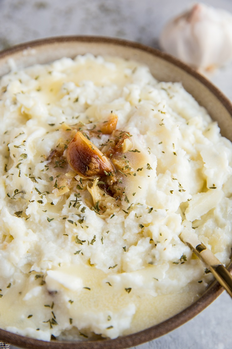 Mashed Cauliflower with Roasted Garlic - keto, low-carb, healthy replacement for mashed potatoes. This creamy cauliflower mash is easy to prepare and a great side dish to any meal!