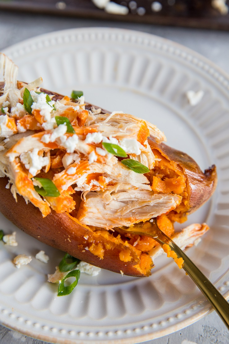 Buffalo Chicken Stuffed Sweet Potatoes with feta and green onion - an easy, healthy dinner recipee